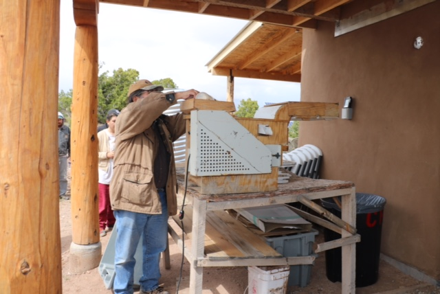 Clayton Brascoupe demonstrating seed cleaning